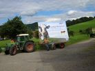 German tractor with sign that says: prices too low - that´s the end of me and my farmer